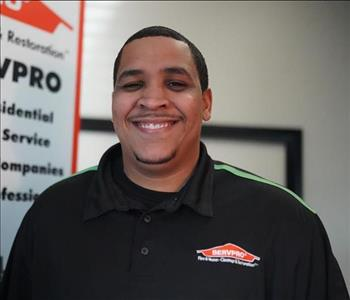 head shot of male crew chief in SERVPRO shirt with low hair cut